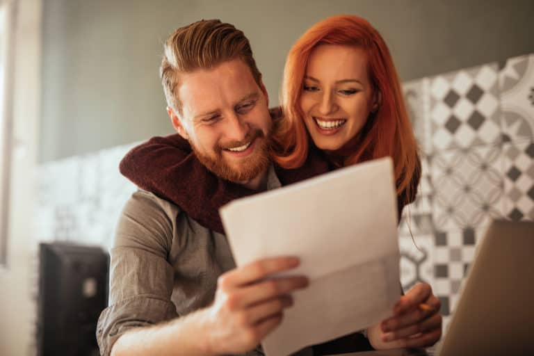 Couple enjoying their income tax refunds